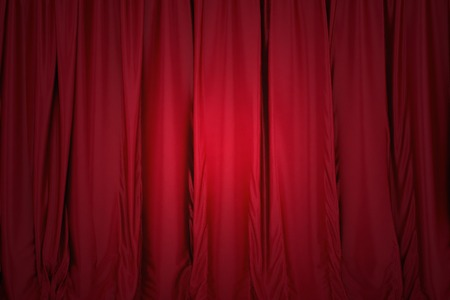 Red closed the curtain, lit by a spotlight photo