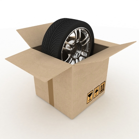 Open Cardboard Box with Tires on white background photo