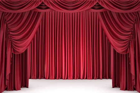 Open red theater curtain, lit by a spotlight photo