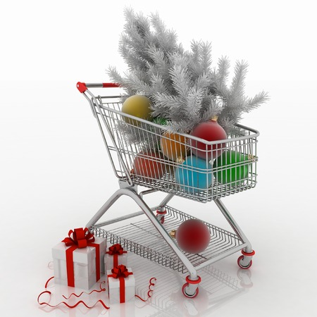 Shopping cart full with christmas balls with fir-tree and gift boxes Stock Photo