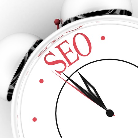 indexing: Time for seo concept clock closeup on white background with red word Stock Photo