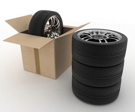 vulcanize: Open Cardboard Box with Tires on white background
