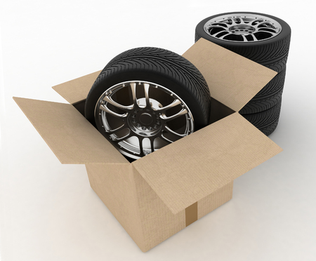 unused: Open Cardboard Box with Tires on white background