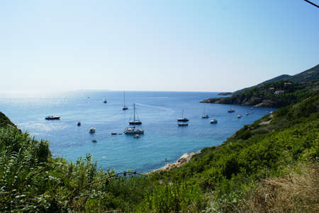 Boats off the coast of Giglio Island in Tuscany, Italy
