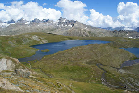 Colle del Nivolet, Italy: panoramic view with the lake and the mountain peaks