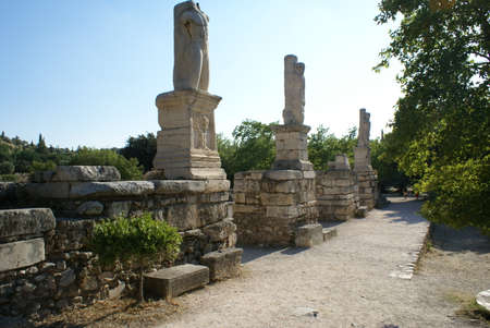 Outdoor pathway flanked by statues in the Ancient Agora of Athens, Greece