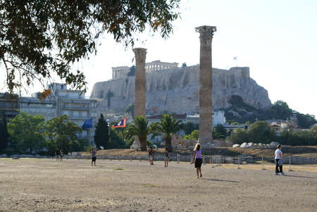 Tourists on the site of the Temple of Zeus (Olympiaion) in Athens, Greece