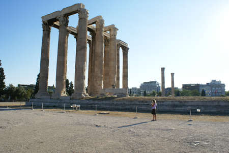 A tourist visiting the ruins of the Temple of Zeus (Olympiaion) in Athens, Greece