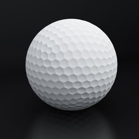 Golf ball on a grey background photo