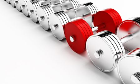 knurled: chrome weights on a white background Stock Photo