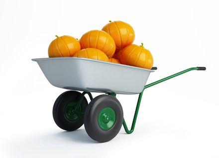 wheelbarrow pumpkins isolated on a white background  photo