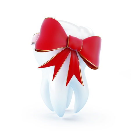 red bow tooth gift on a white background photo
