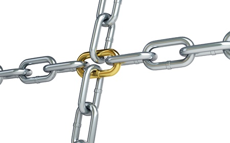 Chrome chain with a gold link on white background photo
