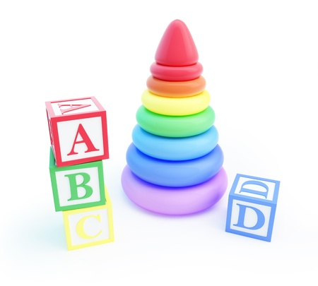 pyramid toy and alphabet blocks on a white background photo