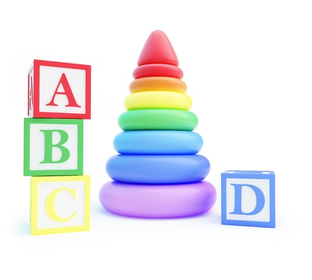pyramid toy and alphabet blocks on a white background Stock Photo - 17577003