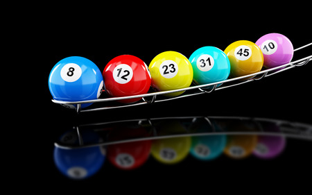 lottery balls on on a black background Stock Photo