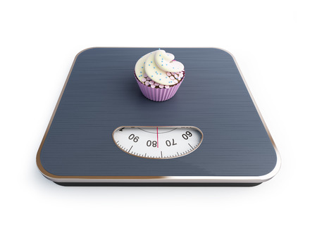 bathroom scale: bathroom scale with the cupcake on a white background