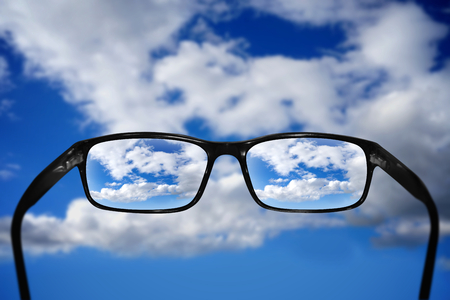 Glasses, vision concept, sky Stock Photo