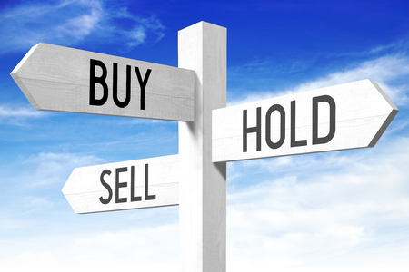 sell: Buy, hold, sell - wooden signpost