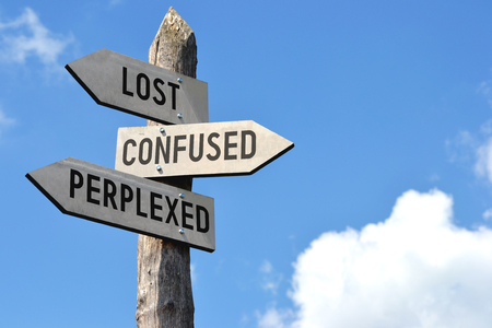 Lost, confused, perplexed signpost Stock Photo