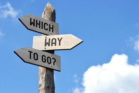 Which way to go? Signpost Stock Photo