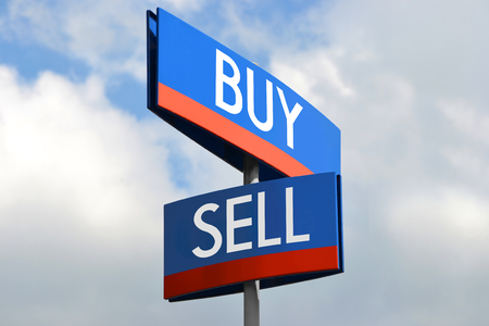sell: Buy and sell street sign Stock Photo
