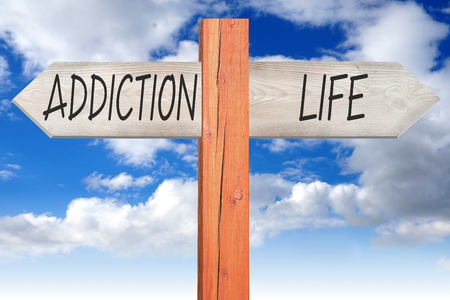 Addiction or life - wooden signpost