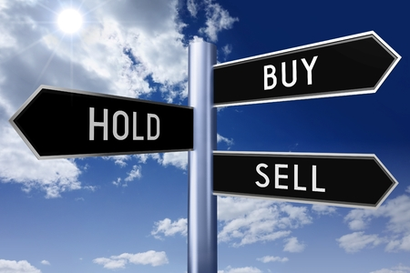 sell: Black signpost - buy, hold, sell Stock Photo