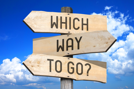 Wooden signpost - which way to go?