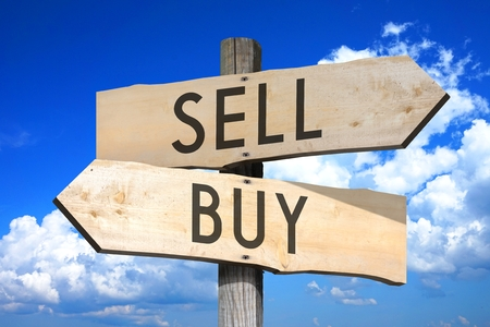 sell: Wooden signpost - buy, sell Stock Photo