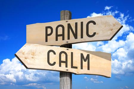 Wooden signpost - panic, calm
