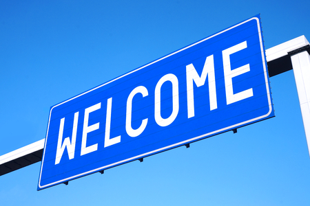 Welcome street sign Stock Photo