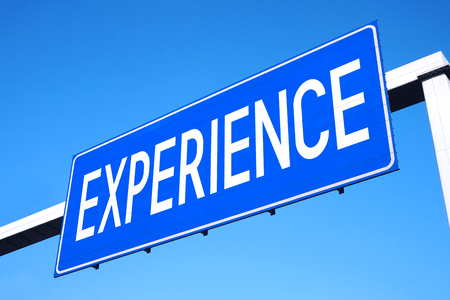 Experience street sign Stock Photo