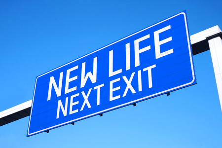 New life - next exit - street sign Stock Photo