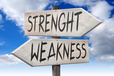 Strength, weakness - wooden signpost Foto de archivo - 95645362