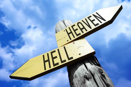 Heaven, hell - wooden signpost