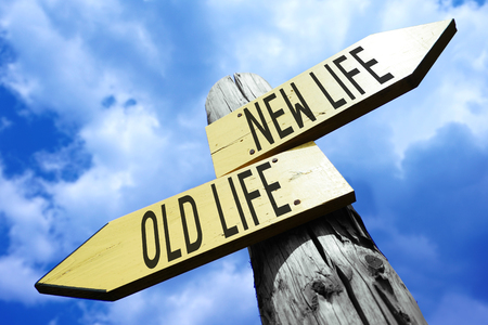 Old life, new life - wooden signpost