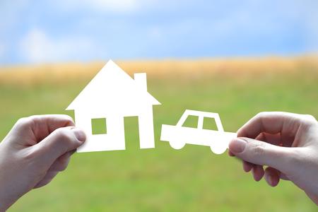 House and car insurance concept, hands, papercut Reklamní fotografie