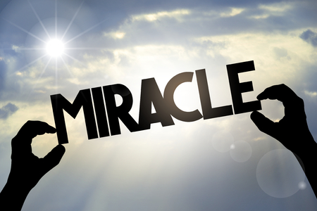 Miracle concept - hands, text, sky Archivio Fotografico