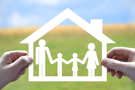 House and family insurance concept, hands, papercut Stock Photo