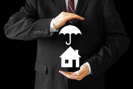 Businessman, house insurance concept