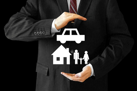 Businessman, house, car and family insurance concept