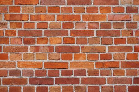 Alte rote Backsteinmauer - toll als Hintergrund Standard-Bild