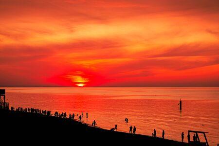 Sunset - sun reflecting in sea ocean, beach