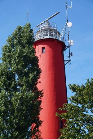 Red lighthouse - side view, trees