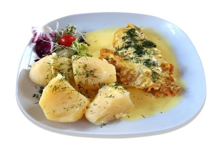 Fried fish - rose fish, salad and potatoes on plate