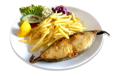 Fried fish - halibut, salad and french fries on plate