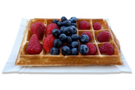 Waffle with fruits - strawberries, blueberries and raspberries
