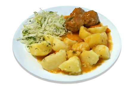 Meatballs - pork, beef, potatoes and salad on plate