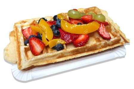 Waffle with fruits - strawberries, blueberries, peaches and grapes